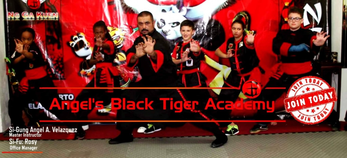Martial arts students with teacher in school of kung fu karate